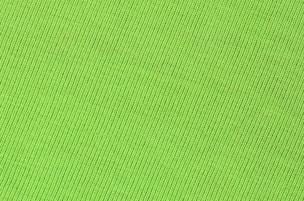 The texture of the fabric is bright green. material for making shirts and blouses