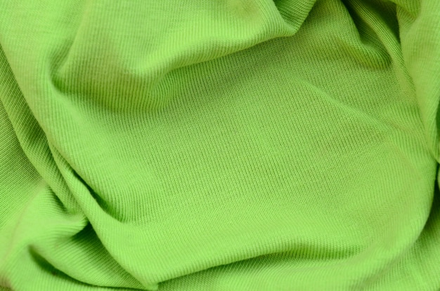 The texture of the fabric is bright green.