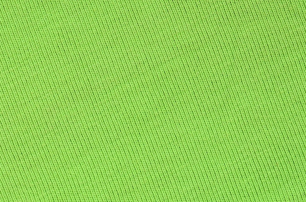 The texture of the fabric is bright green