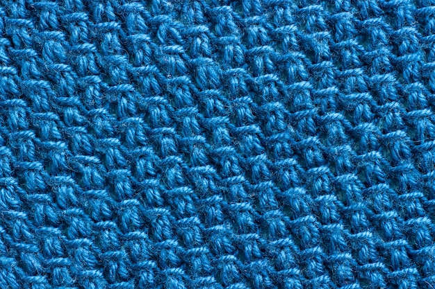Texture of the fabric tied with blue yarn.
