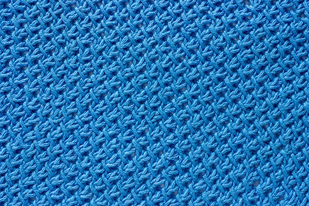 Texture fabric tied with blue yarn.