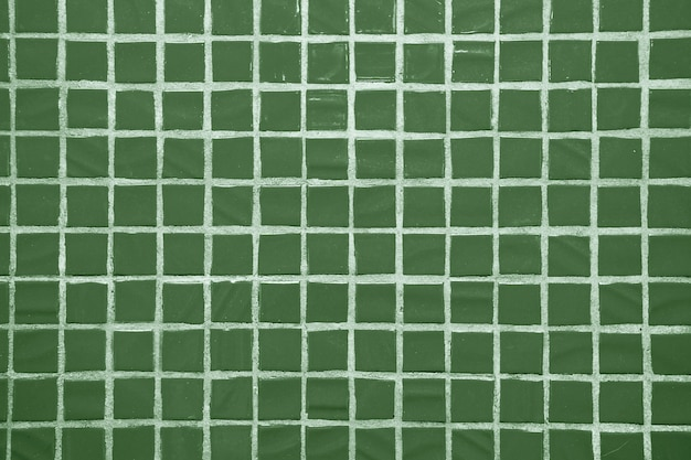 Texture of fine little ceramic tiles. green floor tiles