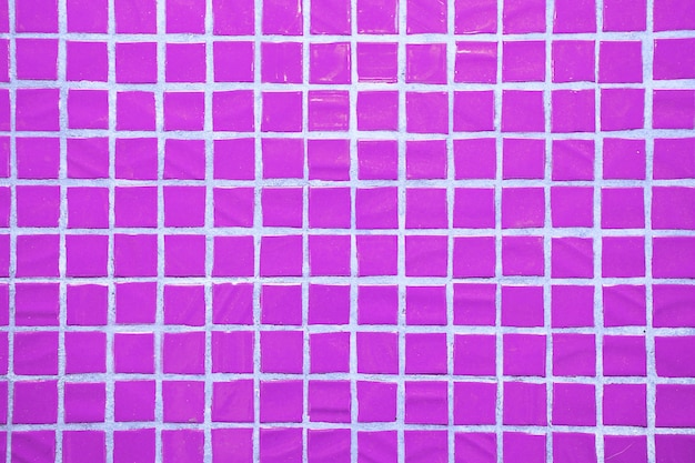 Texture of fine little ceramic tiles. purple floor tiles