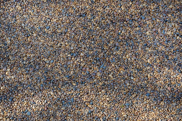 Texture of flashing pebbles background, stone pavement.