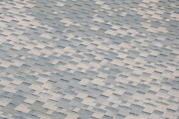 Texture of flat roof tiles with bituminous coating