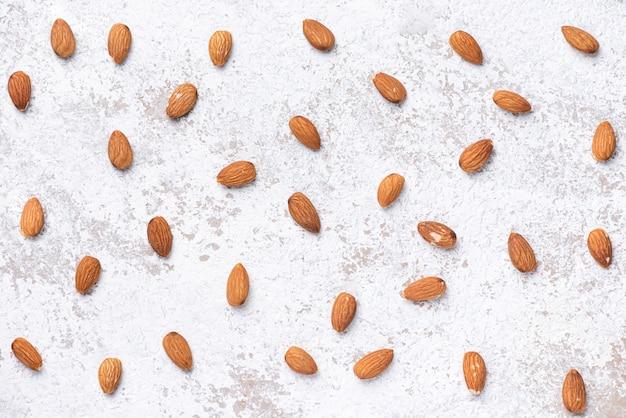 Texture fresh almond on white wall background
