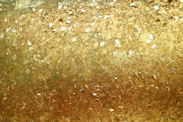 Texture of glittering gold leaves on the buddha image