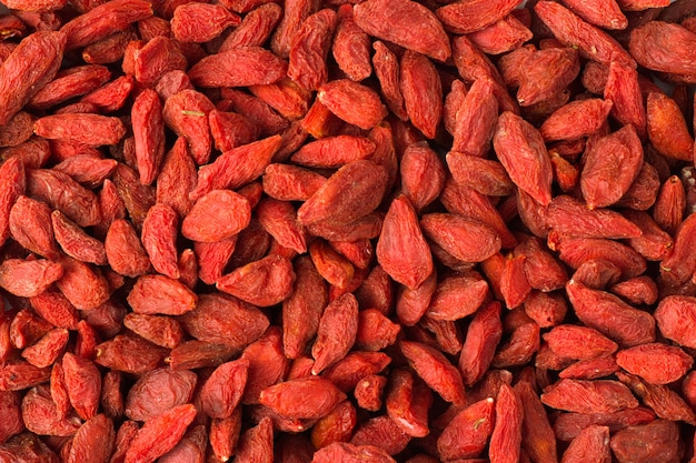 Texture of goji berry close-up, spice or seasoning as background