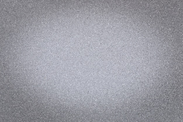 Texture of granite gray color with small dots, with vignetting