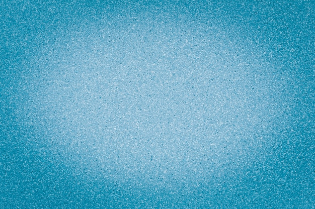 Texture of granite light blue color with small dots, with vignetting, use background.
