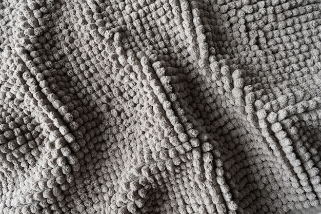 Texture of a gray blanket made of small balls