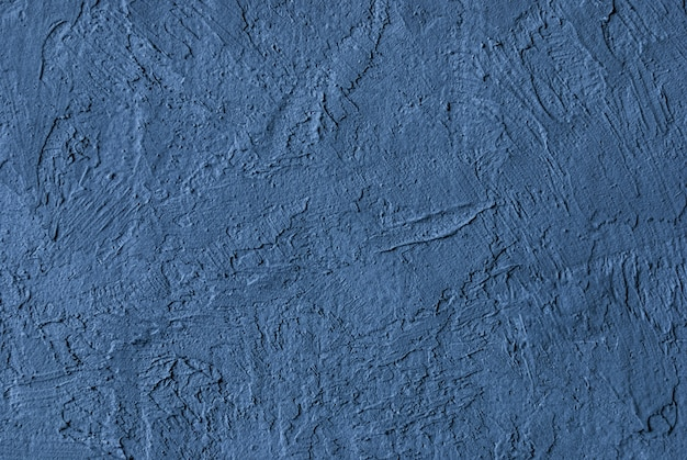 Texture of gray blue uneven concrete wall