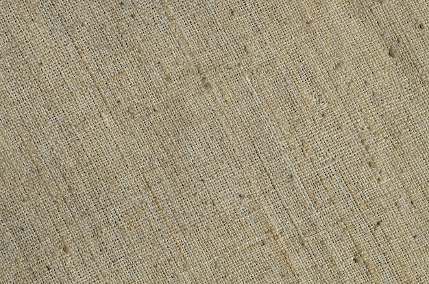 Texture of a gray canvas made of old and coarse burlap. top view