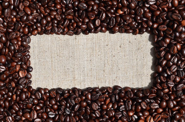 Texture of a gray canvas made of old and coarse burlap with coff