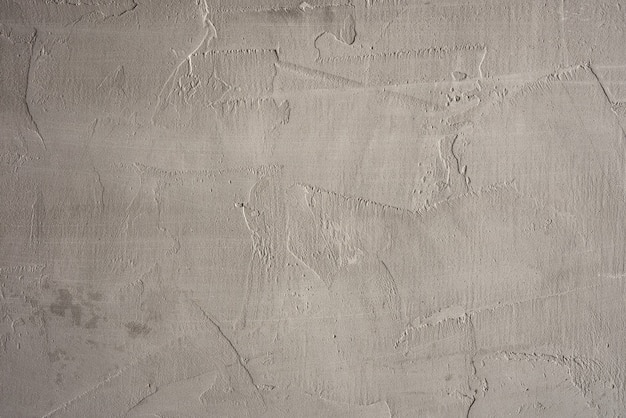 Texture of gray cement wall made with spatula