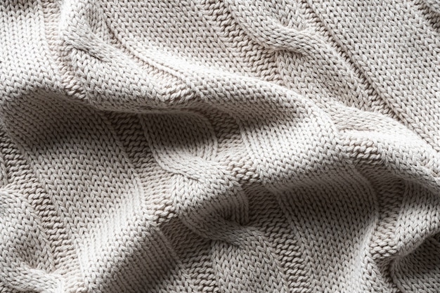Texture gray knitted fabric with a pattern