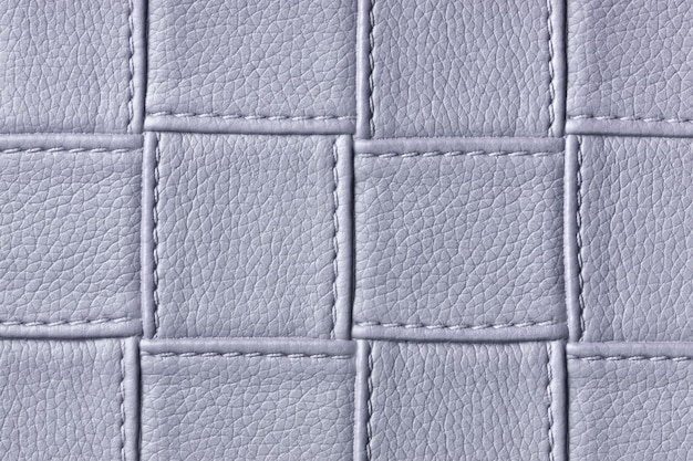 Texture of gray leather background with square pattern and stitch, macro. textile with geometric shape.