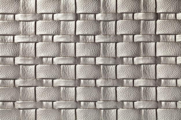 Texture of gray and silver leather background with wicker pattern, macro