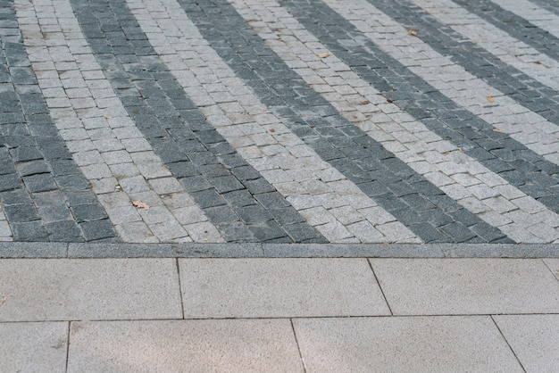 Texture of gray stone paving stones in close-up