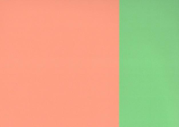 背景の緑とオレンジ色の紙をテクスチャします。