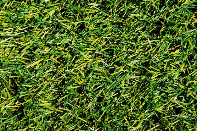 The texture of green artificial grass.covering for sports stadiums and decorations.