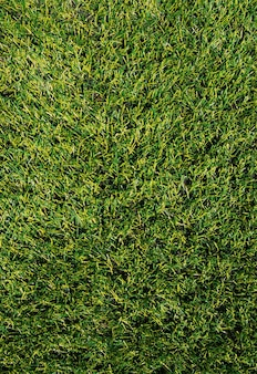 The texture of green artificial grass.covering for sports stadiums.
