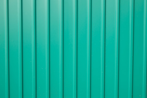Texture green metal siding to finish the outside