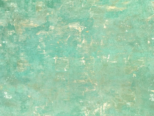 Texture of a green old shabby wooden background. structure of a vintage turquoise painted coating of wood.