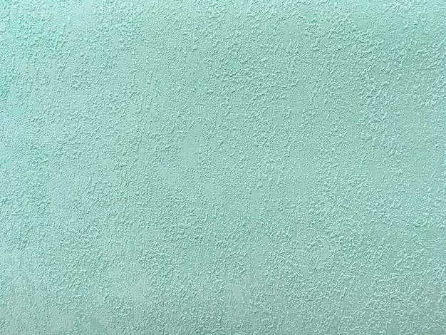 Texture of green wallpaper with a pattern