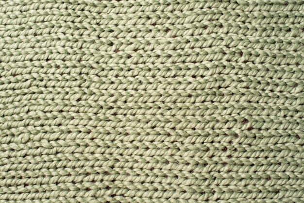 Texture of green wool big knit blanket background