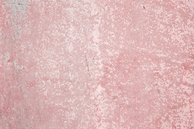 Texture grunge background of concrete stone wall with peeling paint of pink color