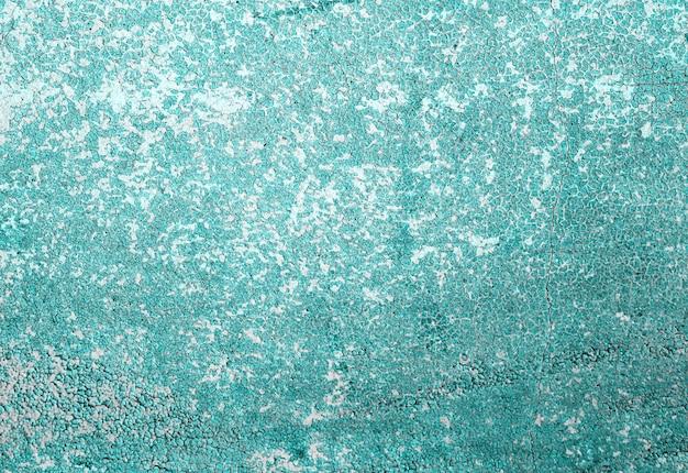 Текстура гранж фон бетонной каменной стеной с облупленной краской синего цвета