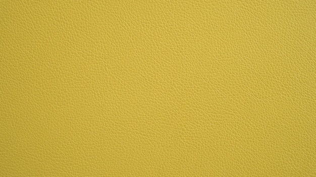 Texture of grunge panorama yellow leather. yellow background.