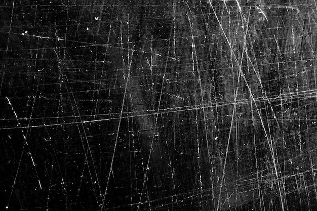 The texture is black with scratches. grunge background
