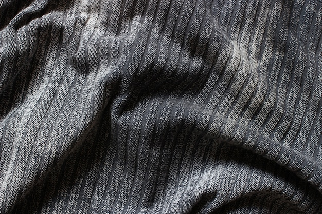 The texture is gray fabric
