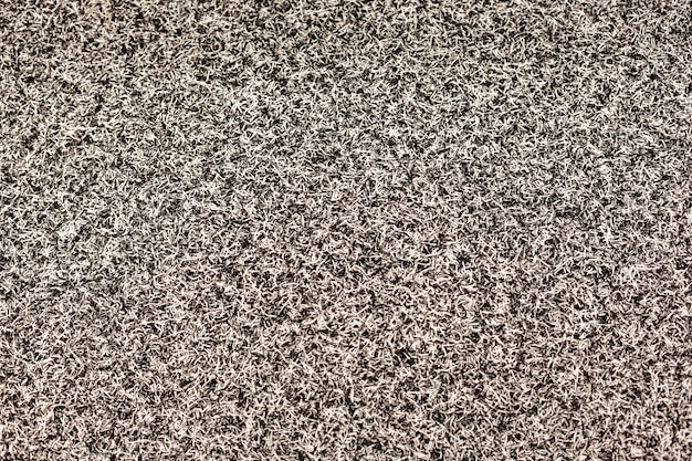 The texture is soft gray carpet