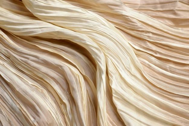 Texture of ivory silk fabric.