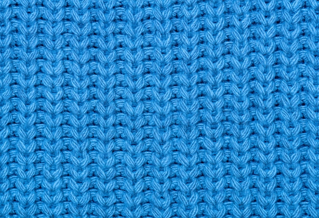 The texture of the knitted fabric in blue.