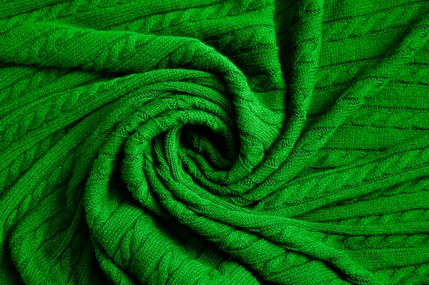 Texture of knitted green fabric. crocheted abstract background.