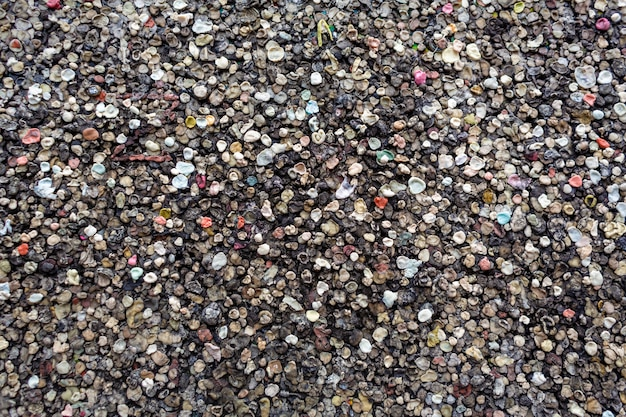 The texture of the landmark berlin wall is covered with chewing gum.