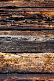 Texture of large logs of a wooden house