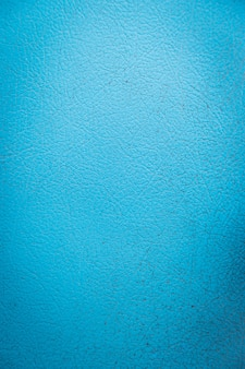 Texture of light blue fake leather surface background