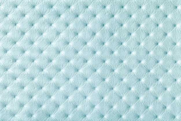 Texture of light blue leather fabric background with capitonner style. denim textile of chesterfield style.