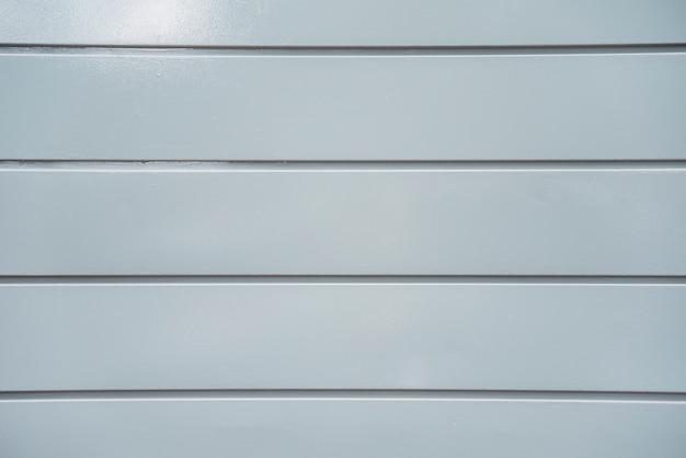 Texture of light grey plastic panel wall