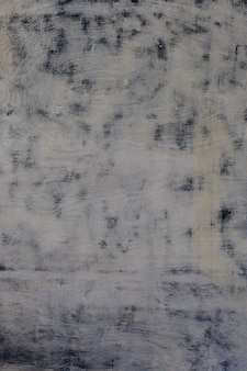 Texture of the light mottled spotted tinted painted aged wooden surface
