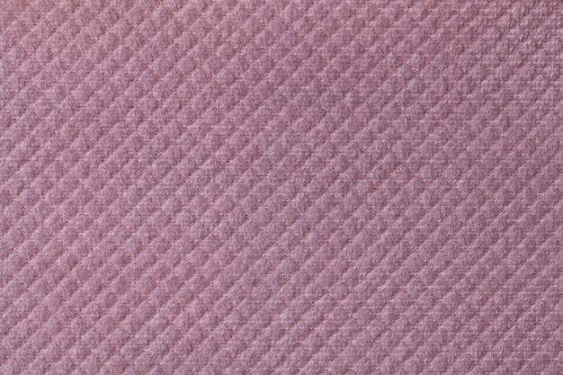Texture of light purple fluffy fabric background with rhomboid pattern, macro