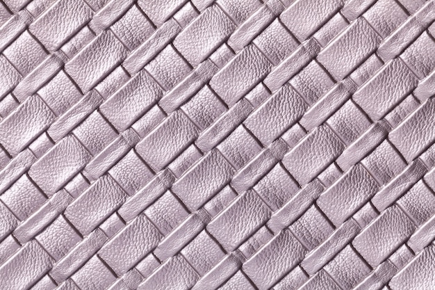 Texture of light purple leather background with wicker pattern, macro. abstract from violet textile.