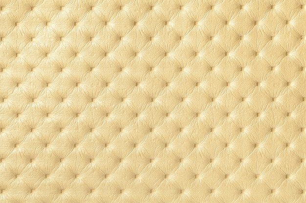 Texture of light yellow leather background with capitone pattern