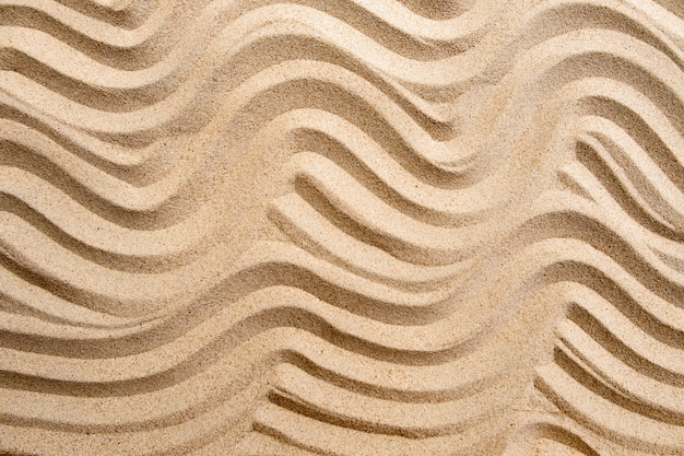 Texture line wave sand on the beach, nature surface background