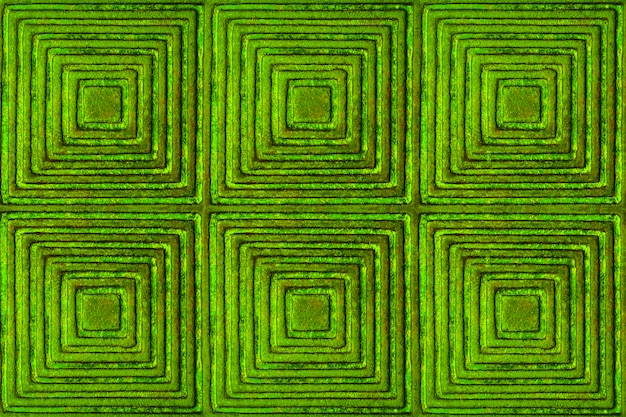The texture of the metal surface with a pattern in the form of squares and rhombuses in green.
